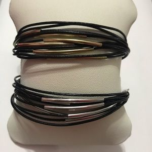 Jewelry - gold and silver on black cord adjustable bracelets